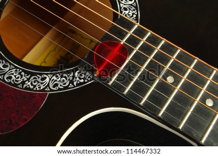 Guitar on a black background. Close up - stock photo