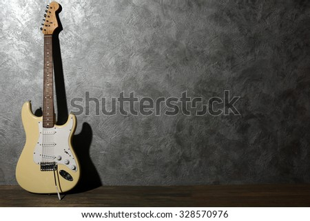Guitar on grey background - stock photo