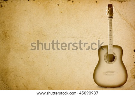 Guitar pictured on old paper - stock photo