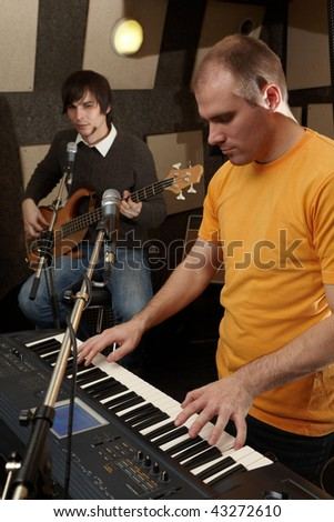 guitar player and keyboarder. practice - stock photo