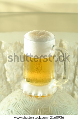 guitar player beveled on a beer mug - stock photo