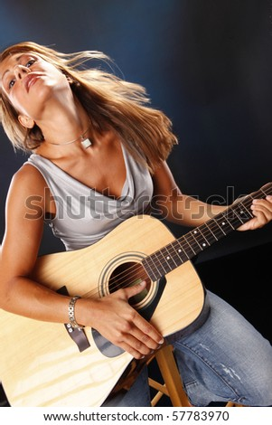 Guitar player performing the blues - stock photo