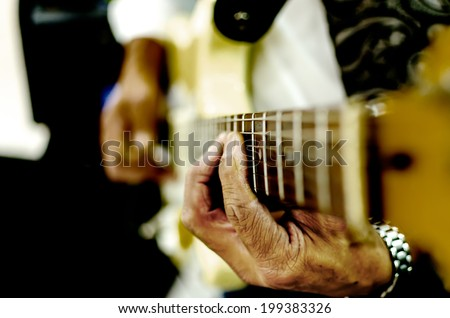 Guitar Playing with dramatic hands - stock photo