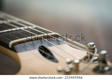 Guitar riff with strings and tuning knobs - stock photo