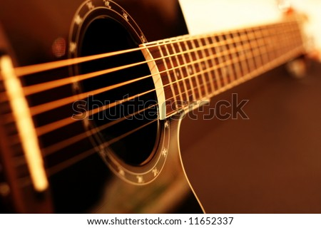 Guitar side view - string, fingerboard. Can be used as a nice background. - stock photo