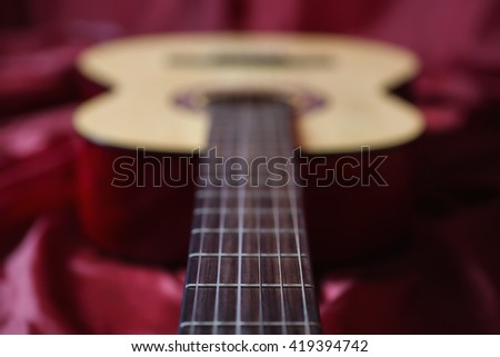 Guitar strings closeup, fretboard, stringed musical instruments, guitar details close up, solo instrument, blues, country, flamenco, rock, metal, jazz   - stock photo