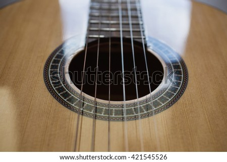 Guitar strings closeup,  fretboard, stringed musical instruments, guitar details close up, solo instrument, blues, country, flamenco, rock,   - stock photo