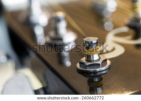 Guitar strings on a guitar's head - stock photo