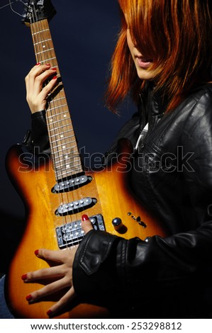 Guitarist girl silhouette - stock photo