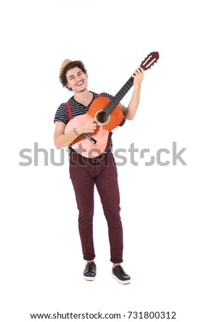 Guitarist Guy Enjoying Playing His Guitar He Is Holding It Up While Standing And Singing