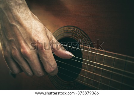 guitarist hand on strings macro