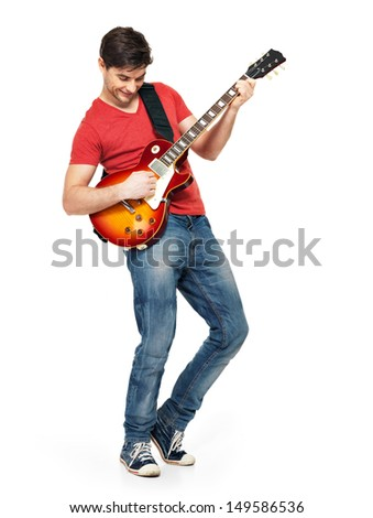 Guitarist  man plays on the electric guitar with bright emotions