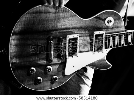 guitarist of a rock band with a guitar - stock photo