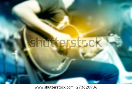 Guitarist on stage, colorful soft and blur for background - stock photo