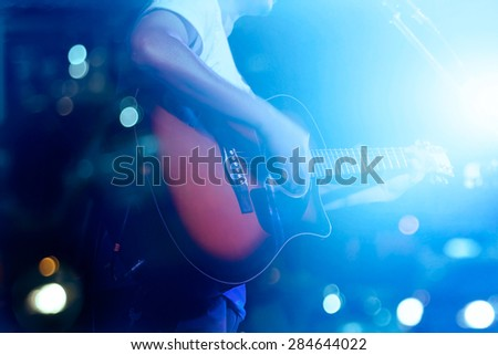 Guitarist on stage grunge background, soft and blur concept - stock photo