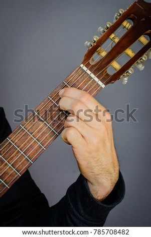 Guitarist Playing E Minor Chord On Stock Photo (Royalty Free ...