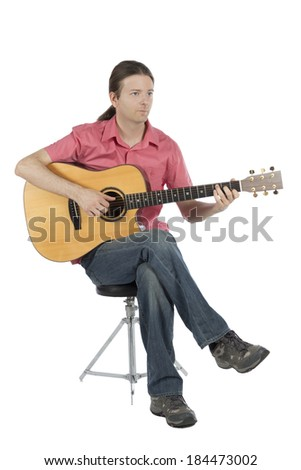 Guitarist playing his guitar.