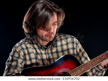 Guitarist playing on the guitar - stock photo