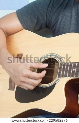 Guitarist plays - stock photo