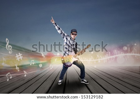 Guitarist with his guitar and musical notes illustration  - stock photo