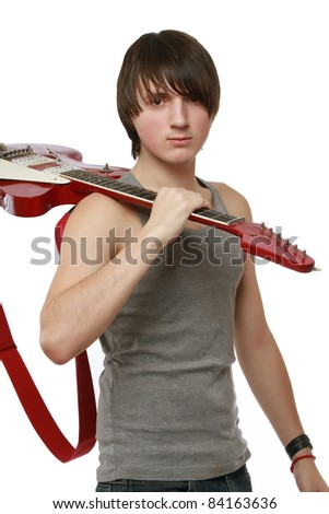 Guitarist with his guitar on the shoulder isolated on white background - stock photo