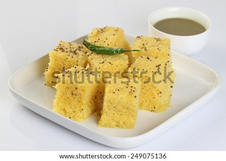 Gujarati Khaman Dhokla or Steamed Gram Flour Snack, Indian Food - stock photo