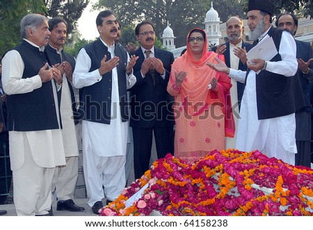 GUJRAT, PAKISTAN - OCT 30: Prime Minister, Syed Yousuf Raza Gilani, offers Fateha (pray) after lays floral wreath at the grave of Nawab Sir Fazal Ali on October 30, 2010 in Gujrat .