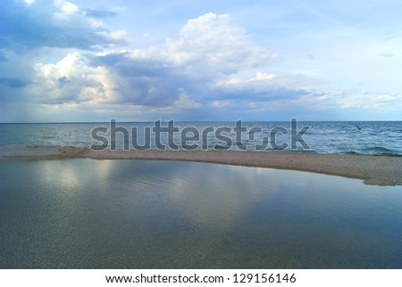 Gulf and long sandy island before storm - stock photo