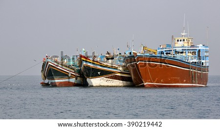 GULF OF ADEN, DJIBOUTI â?? FEBRUARY 7, 2016: Fishing and cargo ships which are used for transportation between Yemen and Djibouti, for cargo transportation in the Red Sea and Indian Ocean - stock photo