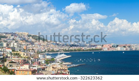 Gulf of Naples, cityscape under blue cloudy sky - stock photo