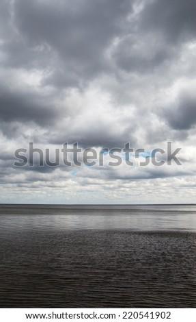 Gulf of Riga, Baltic sea in dark autumn day. - stock photo