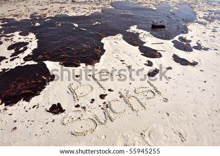 GULF SHORES, ALABAMA - JUNE 12: Gulf oil spill is shown on a beach on June 12, 2010 in Gulf Shores, Alabama. - stock photo