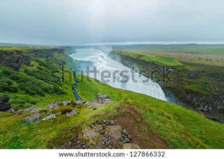 Gullfoss (Golden Falls) waterfall and rainbow in the Iceland - stock photo