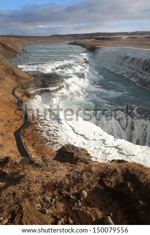 Gullfoss waterfall, iceland, with ice remains after the winter. afternoon lighting - stock photo