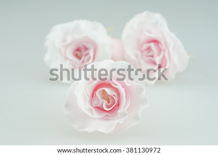 Gum paste pink roses for cake decoration   - stock photo