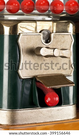 Gumball machine dropping red gumball. - stock photo