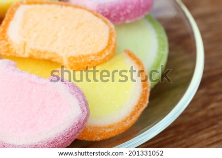 Gumdrops on a transparent plate - stock photo