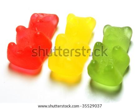 Gummi bears on a light grey background - stock photo