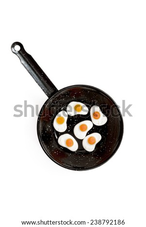 Gummy fried egg in pan on white background - stock photo