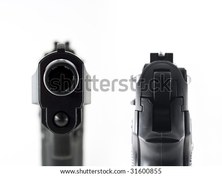 gun aiming and staring into the barrel - stock photo