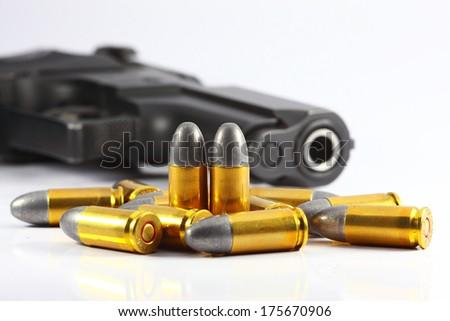 Gun and bullet  - stock photo