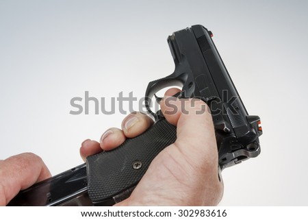 gun and bullets in the shooter's hand