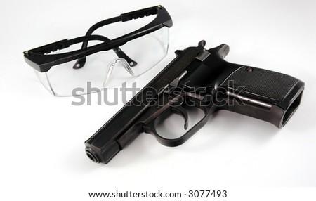 Gun and glasses - stock photo