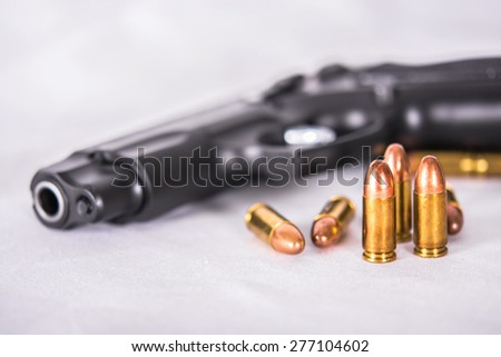 Gun and group of Bullets,ammunition on White background - stock photo