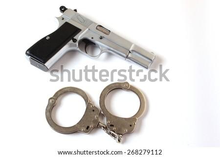 gun and handcuffs - stock photo