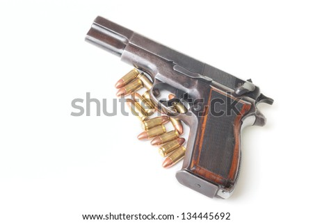Gun and 9mm cartridges isolated on white background - stock photo
