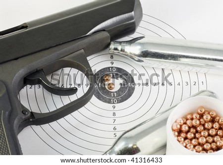 gun and weapon accessories are in a hole in the target - stock photo