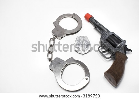 Gun, Badge and Handcuffs - stock photo