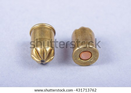 Gun cartridge case isolated on the gray background - stock photo