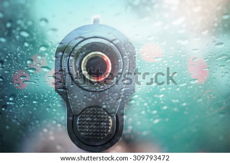 Gun close up and focus on one point and  shallow depth of field - stock photo